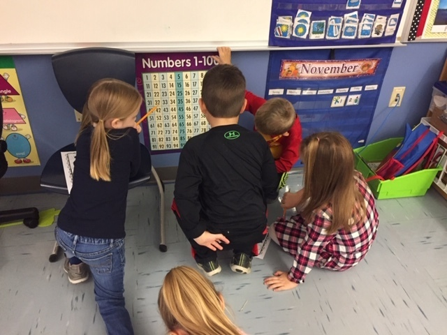 First graders solving math problems together!