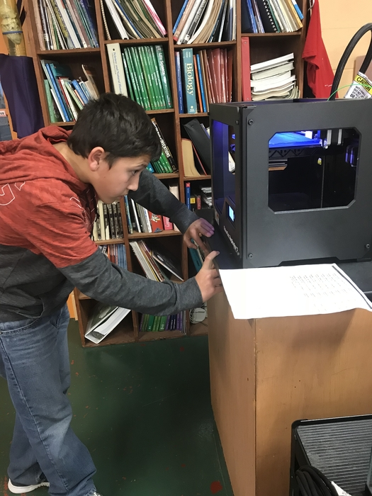 Trevor works on his 3D printing.