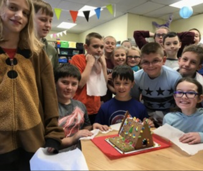 Mrs. Choate's friends show their Gingerbread creation.