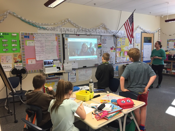 Students interacting with a class in MN over Skype!
