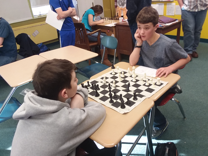 Sam and Ryder compete in Chess Club.